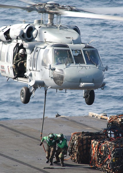 US Navy 040623-N-1082Z-002 An MH-60S Knighthawk assigned to the Chargers of Helicopter Combat Support Squadron Six (HC-6), Detachment 6, transports supplies to USS George Washington (CVN 73)