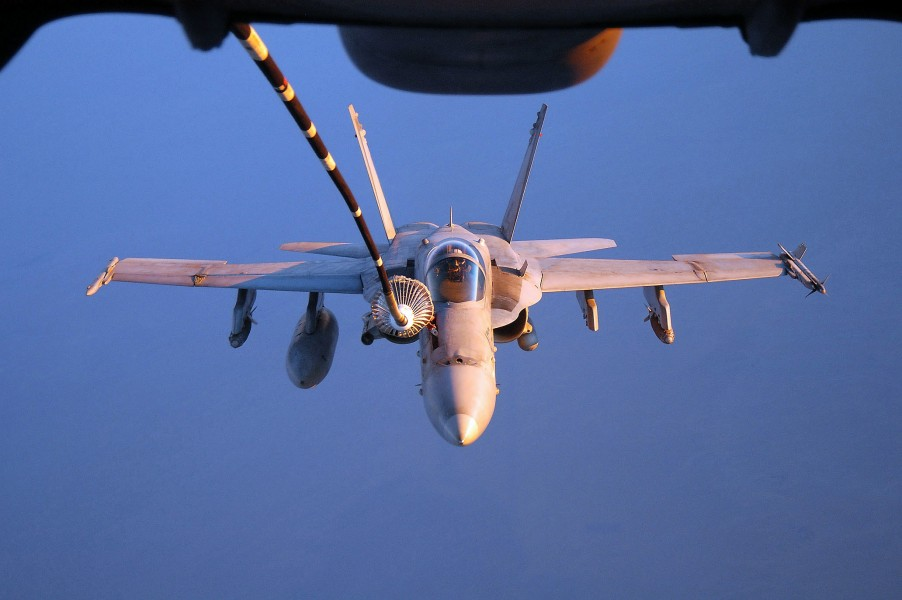 US Navy 050913-F-5480T-039 An F-A-18C Hornet refuels from a U.S. Air Force KC-10 Extender aerial tanker