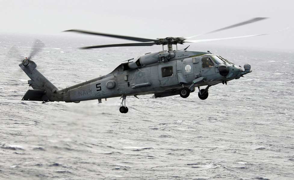 US Navy 060310-N-4166B-027 A SH-60F Seahawk helicopter assigned to Helicopter Anti-Submarine Squadron Two (HS-2) flies toward the Nimitz-class aircraft carrier USS Abraham Lincoln (CVN 72) for a landing