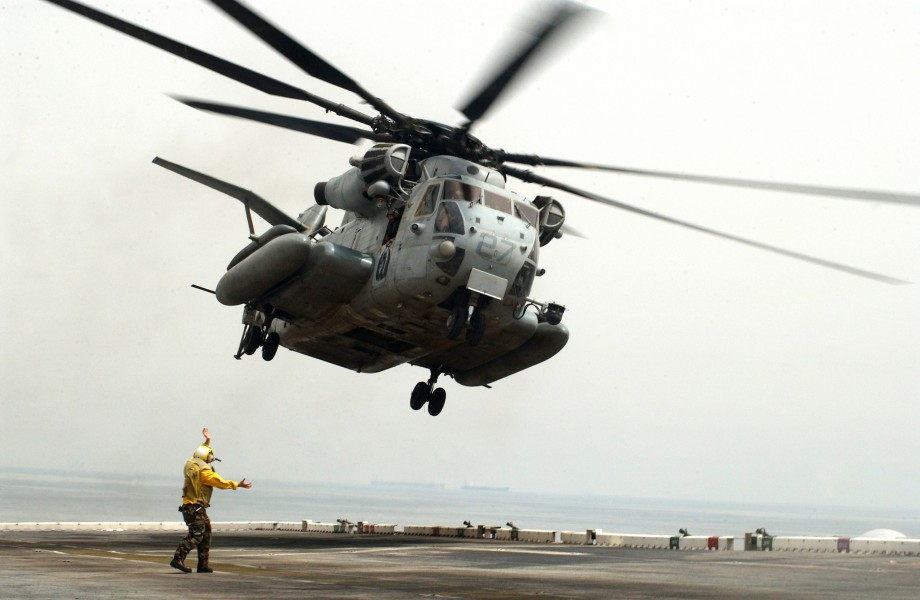 US Navy 060430-N-9866B-042 A CH-53 Super Stallion helicopter takes off from the flight deck aboard the amphibious assault ship USS Peleliu (LHA 5)