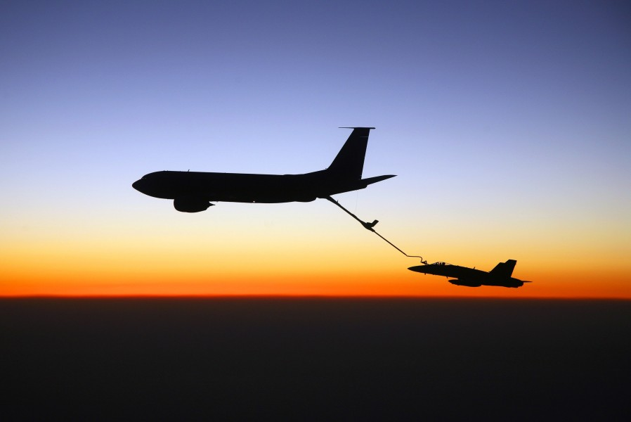 US Navy 070827-N-6346S-766 An F-A-18C Hornet, assigned to the Knighthawks of Strike Fighter Squadron (VFA) 136, receives fuel from an Air Force KC-135 tanker over southern Iraq