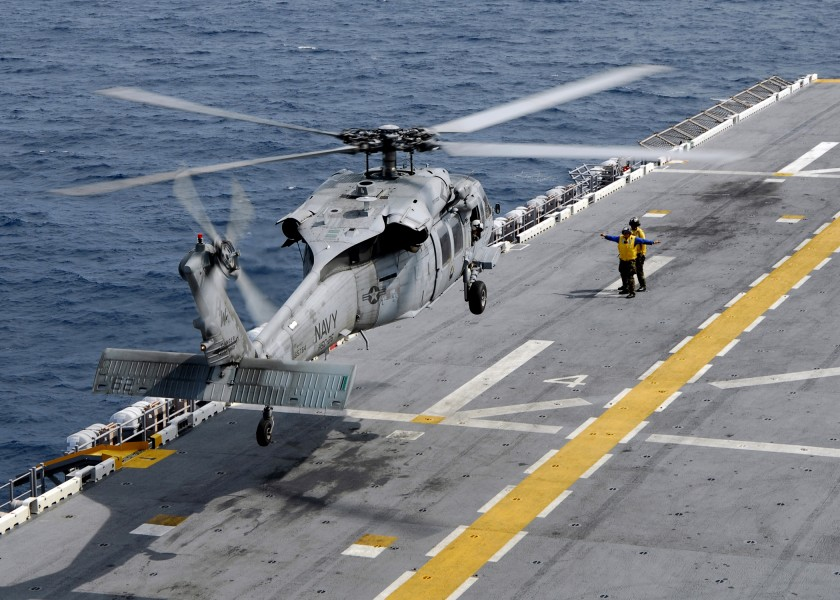 US Navy 080828-N-4236E-589 An MH-60S Sea Hawk helicopter lands on the flight deck of the multi-purpose amphibious assault ship USS Iwo Jima (LHD 7)
