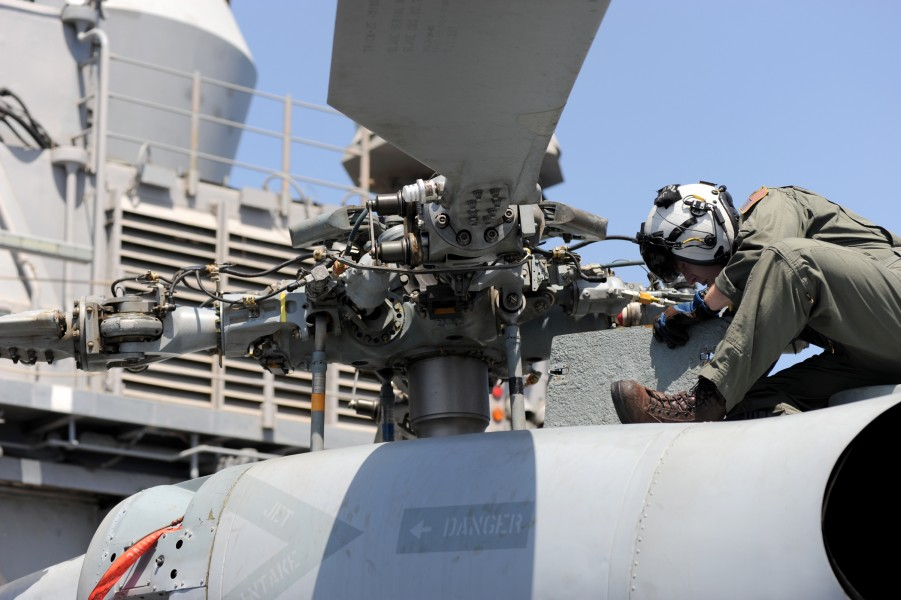 US Navy 100512-N-0553R-036 Sailor checks helicopter before flight aboard USS San Jacinto