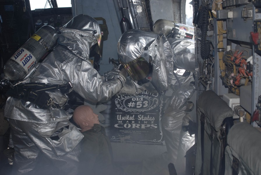 US Navy 100619-N-3358S-024 Sailors perform a simulated rescue inside a CH-53E Super Stallion helicopter during a fire drill aboard the amphibious transport dock ship USS Mesa Verde (LPD 19)