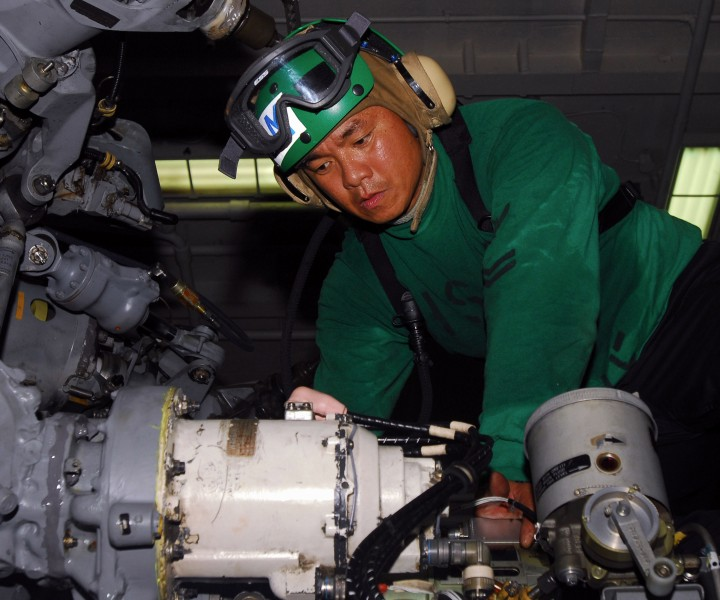 US Navy 100908-N-1276B-189 Aviation Structural Mechanic 2nd Class Joselito C. Centino nstalls a hydraulic pump on an SH-60F Sea Hawk helicopter abo