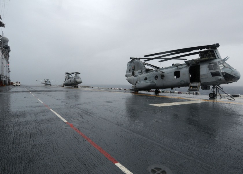 US Navy 101105-N-3265K-034 CH-46E helicopters are secured on the flight deck of the multi-purpose amphibious assault ship USS Iwo Jima (LHD 7)