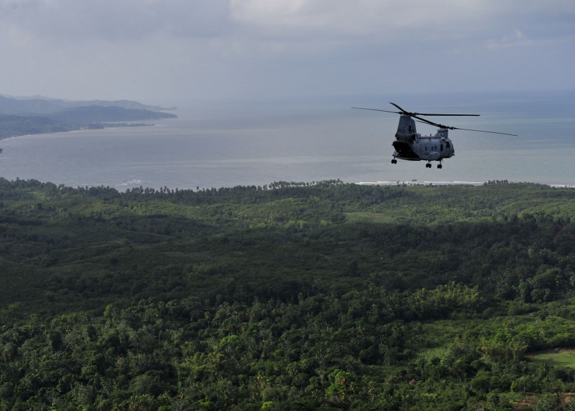 US Navy 101106-N-1531D-030 A CH-46E Sea Knight helicopter conducts aerial damage assessments of Haiti after Hurricane Tomas made landfall