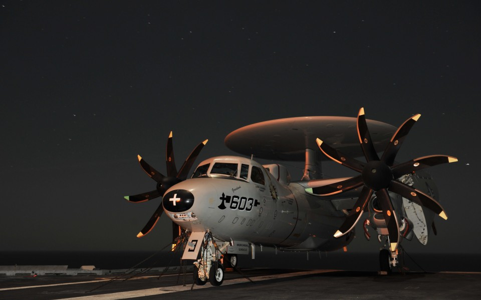 US Navy 101219-N-5016P-002 An E-2C Hawkeye is chained to the flight deck aboard USS Abraham Lincoln (CVN 72)