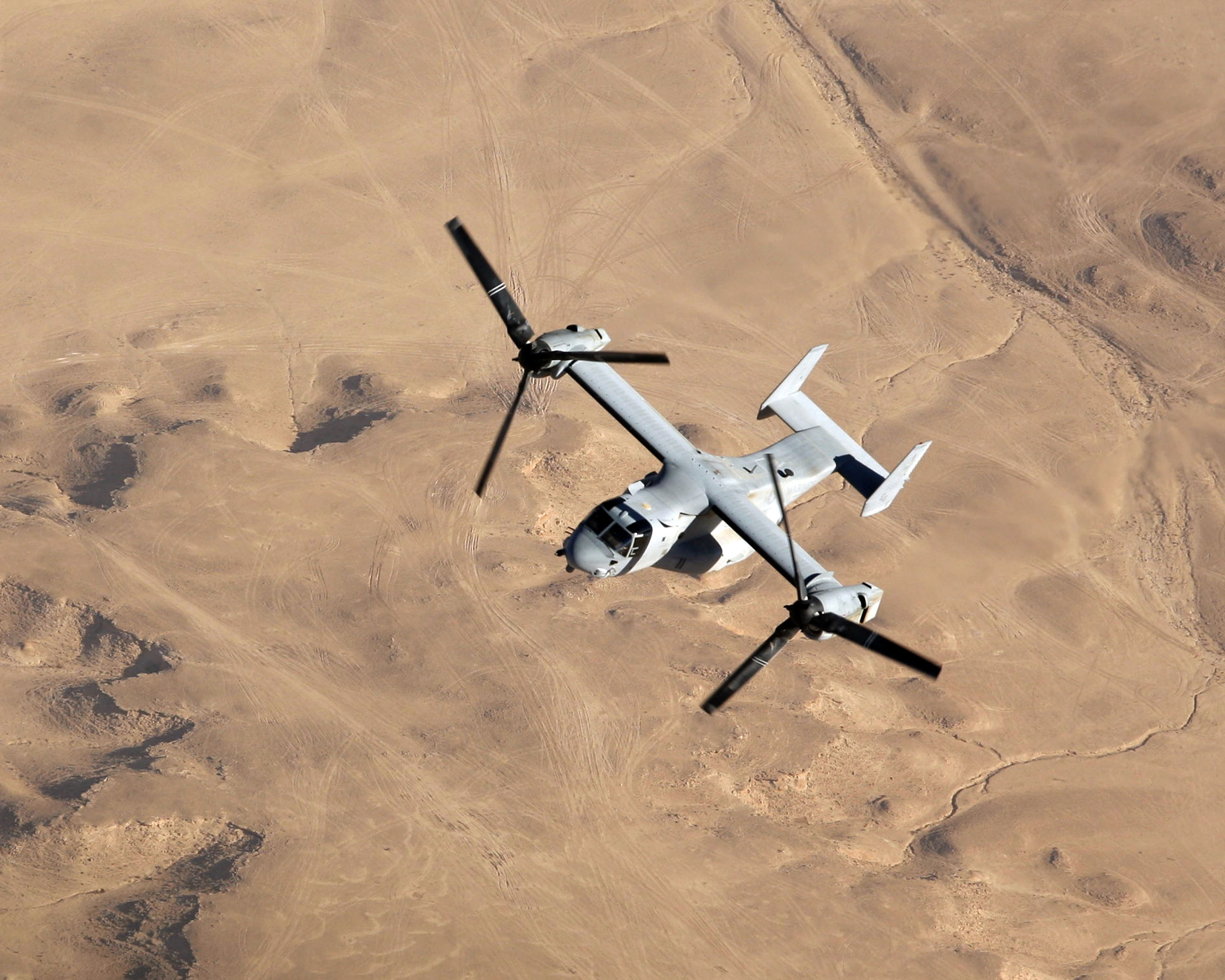 US Navy 071110-M-7404B-036 An MV-22B Osprey with Marine Medium Tilt rotor Squadron-263, flies over the Al Anbar Province of Iraq during a mission out of Al Asad Air Base