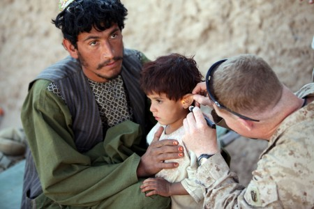 Defense.gov News Photo 101122-M-3860M-149 - Chief Petty Officer David Worrell the leading chief hospital corpsman for 3d Battalion 25th Marine Regiment treats an Afghan child during a