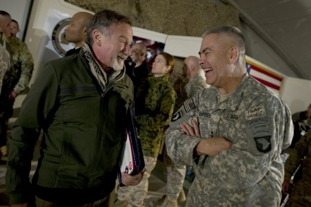 Defense.gov News Photo 101215-N-0696M-193 - Comedian Robin Williams visits with Commanding General of Combined Task Force 101 U.S. Army Lt. Gen. John F. Campbell after the USO Holiday Tour