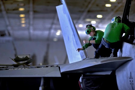 Defense.gov News Photo 110224-N-2055M-235 - U.S. Navy Petty Officer 3rd Class Jessica Murphy assigned to Strike Fighter Squadron 22 performs maintenance on an F A-18F Super Hornet aircraft