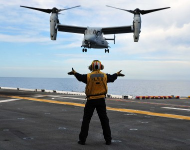 Defense.gov News Photo 110301-N-KD852-038 - An MV-22 Osprey tiltrotor aircraft attached to Marine Medium Tiltrotor Squadron 166 approaches the flight deck of the amphibious assault ship USS