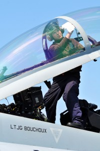 Defense.gov News Photo 110413-N-1004S-222 - Airman Steven Gardner assigned to Strike Fighter Squadron 154 cleans the cockpit window of an F A-18F Super Hornet aboard the aircraft carrier