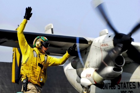 Defense.gov News Photo 110630-N-GL340-109 - U.S. Navy Lt. Jerrod Washburn signals the launch of a C-2A Greyhound from the aircraft carrier USS Ronald Reagan CVN 76 in the Arabian Sea on June