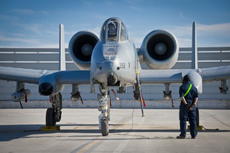 Defense.gov News Photo 120120-F-XH170-115 - A 451st Expeditionary Aircraft Maintenance Squadron crew chief waits for the pilot s call to pull the chocks during an A-10 Thunderbolt II aircraft