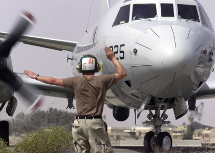 US Navy 030411-N-8921O-003 Aviation Structural Mechanic Airman Frank Wendt signals a right turn for a P-3C Orion