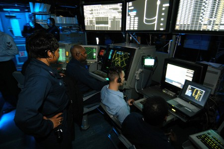 US Navy 031217-N-6278K-001 Air Traffic Controllers man the Carrier Air Traffic Control Center (CATCC) during flight operations aboard USS George Washington (CVN 73)