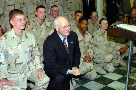 US Navy 041207-N-5608F-020 U.S. Vice President Dick Cheney takes a moment to pose with several service members in the dinning facility in Bagram, Afghanistan