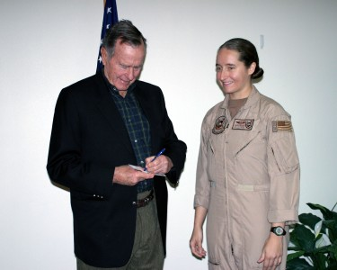 US Navy 060118-N-3207B-088 Patrol Squadron Four Seven's (VP-47) Senior Sailor of the Year, Aviation Machinist's Mate 1st Class Cindy Baker, receives an autograph