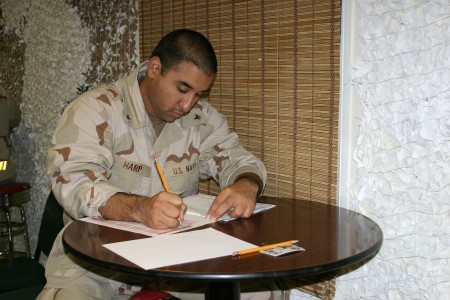 US Navy 060309-N-3207B-003 Culinary Specialist 3rd Class Ricardo Harp assigned to Patrol Squadron Four Seven (VP-47) participates in the E-5 Navy-wide Advancement Exam