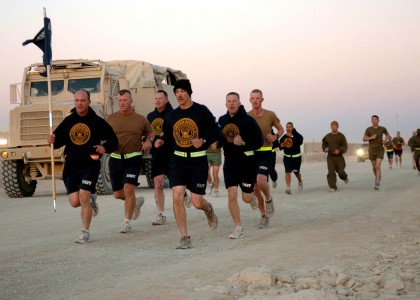 US Navy 091013-N-4440L-068 Seabees assigned to Alfa Company of Naval Mobile Construction Battalion (NMCB) 74 run with their company guidon during a 5-kilometer run at Camp Leatherneck, Afghanistan