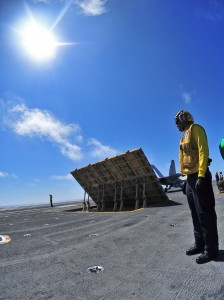US Navy 100712-N-2953W-055 Sailor directs aircraft aboard USS Carl Vinson