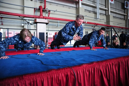 US Navy 101026-N-7526R-243 Master Chief Petty Officer of the Navy (MCPON) Rick D. West does a clapping push-up during an all-hands call at Naval Ai