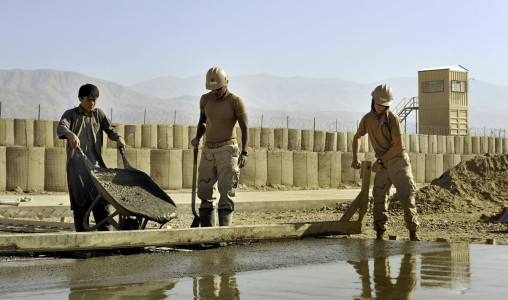 US Navy 101123-N-6436W-070 Seabees assigned to Naval Mobile Construction Battalion (NMCB) 40 work with Afghani contractors to place concrete for he