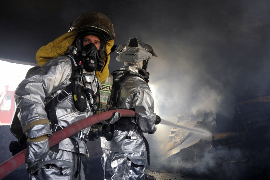 Defense.gov News Photo 100809-F-6188A-164 - Firefighters from the 447th Expeditionary Civil Engineer Squadron extinguish a fire in a training room during live-burn training at Baghdad