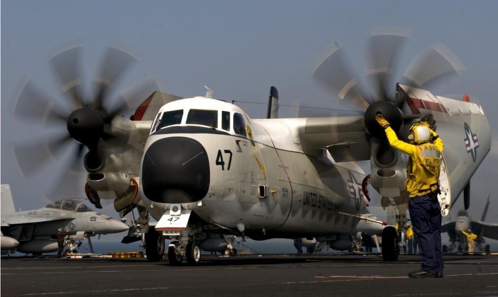 Defense.gov News Photo 110303-N-6320L-091 - Petty Officer 2nd Class Mario Billote guides a C-2A Greyhound assigned to Fleet Logistics Support Squadron 40 aboard the aircraft carrier USS Carl