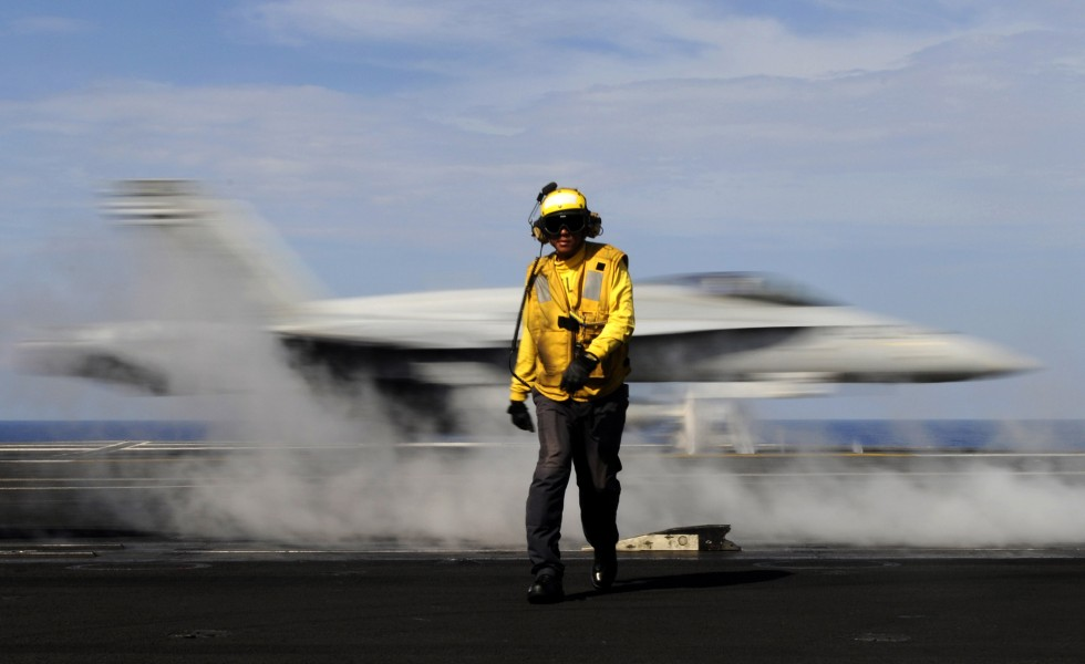 Defense.gov News Photo 110513-N-GZ277-144 - Petty Officer 2nd Class Jason Querido assigned to the air department of the aircraft carrier USS Carl Vinson CVN 70 works as an aircraft