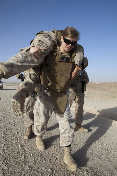 Defense.gov News Photo 110530-M-CL319-238 - U.S. Marine Corp Cpl. Kelly Campagna assigned to Marine Aviation Logistics Squadron 40 performs a fireman s carry with Cpl. Lance Rowewood during