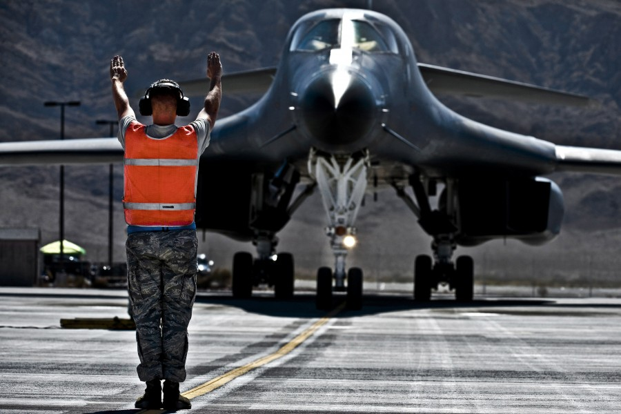 Defense.gov News Photo 110920-F-KX404-055 - U.S. Air Force Senior Airman Jonathon Hartman directs the flight crew of a B-1B Lancer aircraft during Green Flag-West 11-10 at Nellis Air Force