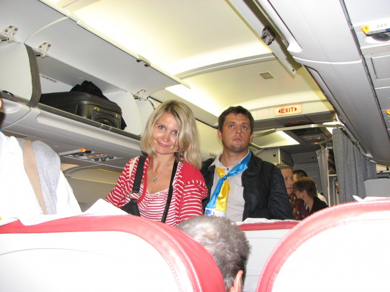 A beautiful Catholic couple - a wife with her husband - during a flight from Tel-Aviv, Israel