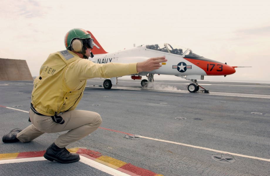 US Navy 030726-N-0696M-014 Lt. Benjamin VanBuskirk gives the signal to launch a T-45 Goshawk