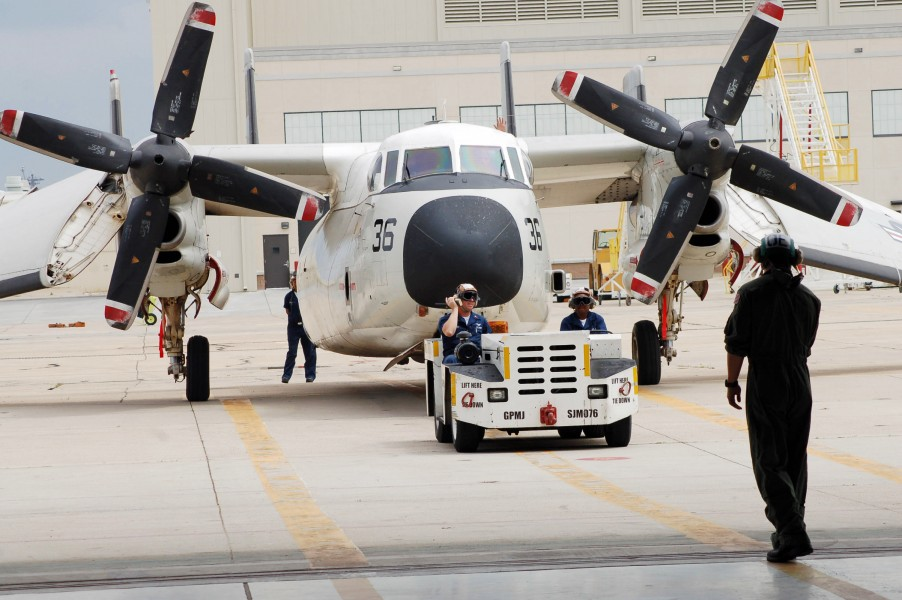 US Navy 060428-N-9689V-025 Fleet Logistics Support Squadron Three Zero (VRC-30) Sailors tow a C2-A Greyhound aircraft into the hangar for maintenance