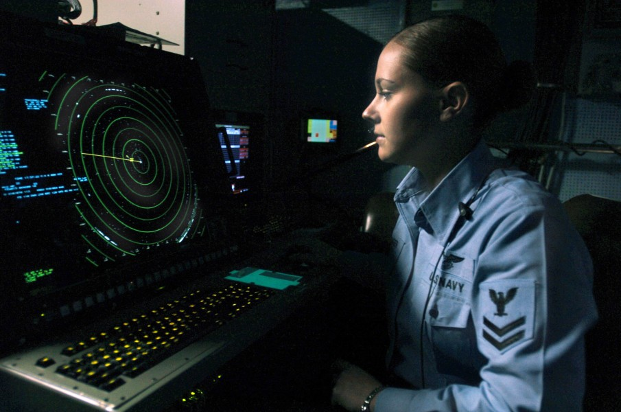 US Navy 061209-N-5248R-001 Air Traffic Controller 2nd Class Emmily Trolinger from Farmington, Mo., stands watch as aircraft departure controller in Carrier Air Traffic Control Center
