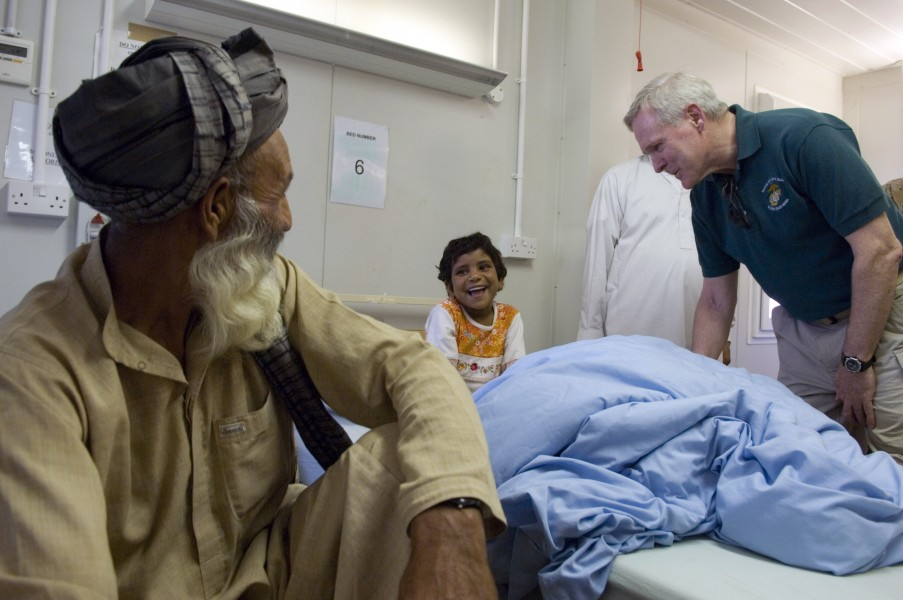 US Navy 090809-N-5549O-098 Secretary of the Navy (SECNAV) the Honorable Ray Mabus speaks to an Afghan girl while touring a hospital at Camp Bastion, Afghanistan