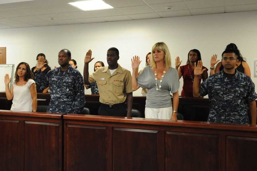 US Navy 100720-N-1938G-002 Candidates for U.S. citizenship recite the oath of citizenship during a naturalization ceremony at Naval Air Station Sigonella