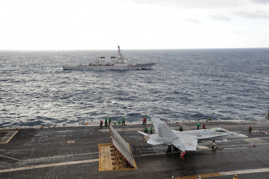 US Navy 101026-N-3418M-123 The aircraft carrier USS George Washington (CVN 73) conducts routine flight operations while the Arleigh Burke-class gui