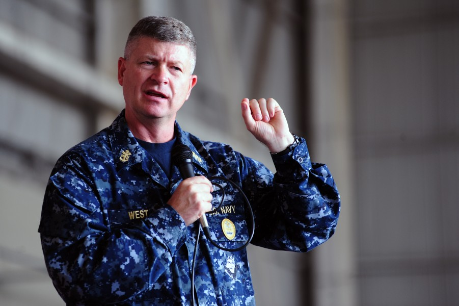 US Navy 101026-N-7526R-214 Master Chief Petty Officer of the Navy (MCPON) Rick D. West answers questions from Sailors during an all-hands call at N