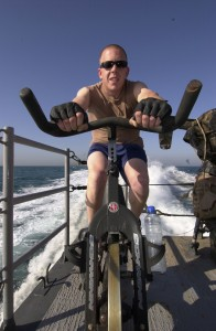 US Navy 050507-N-3289C-028 Gunners Mate 2nd Class Matthew Maple, from Pittsburgh, Pa., takes time out to stay physically fit by training on a stationary bike aboard the costal patrol ship USS Sirocco (PC 6)
