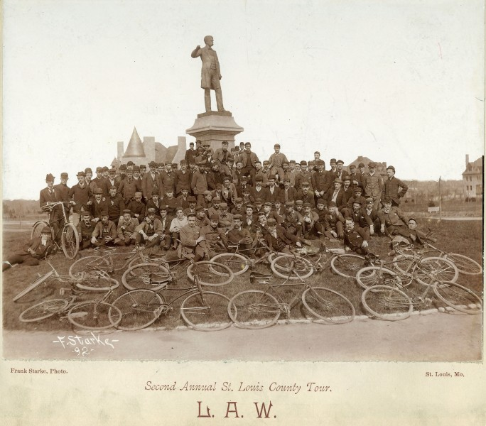 1892 Bicyclists pose near Frank Blair statue, Forest Park, St Louis. MoHIST PHO 10223