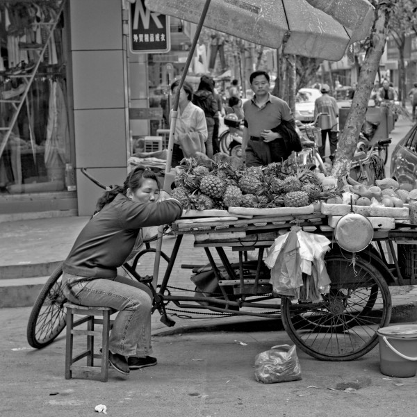 A woman sleeping on fruit stand
