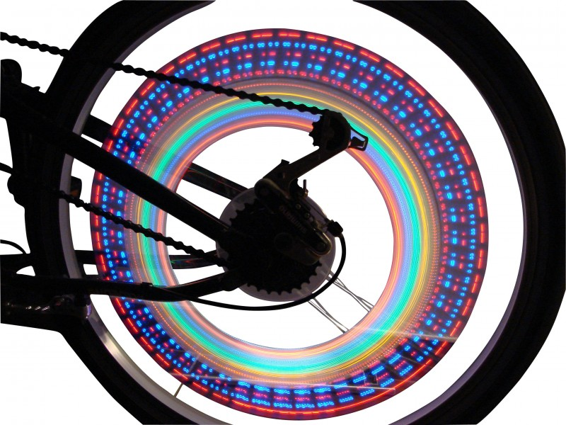 Luminous shapes on rear wheel of bicycle