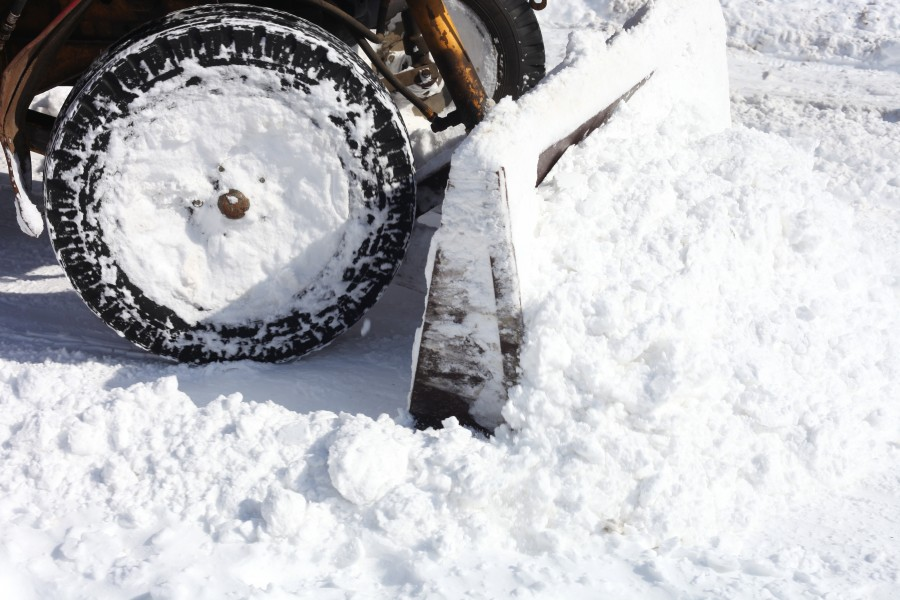 a tractor cleaning snow from a street in Lviv city