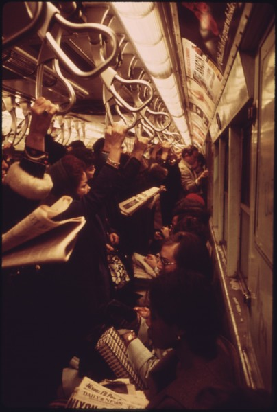 HANGING STRAPS STEADY STANDING PASSENGERS ON THE LEXINGTON AVENUE LINE OF THE NEW YORK CITY TRANSIT AUTHORITY SUBWAY.... - NARA - 556661
