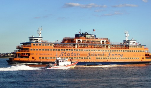 Coast Guard patrol boat passes a Staten Island Ferry boat