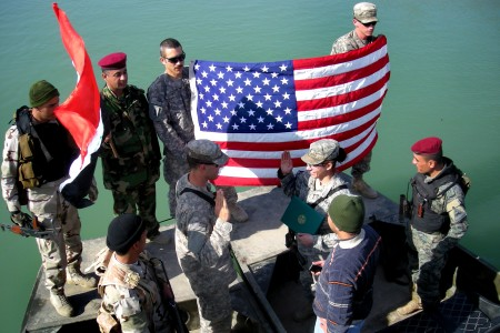 Flickr - The U.S. Army - Soldier celebrates re-enlistment with Iraqi counterparts